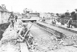 Tankdozer crossing Airel Bridge, July 1944